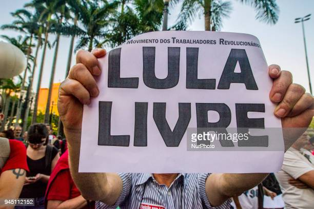 Supporters of Brazilian former president Luiz Inacio Lula da Silva hold a demonstration outside of Se Cathedral in Sao Paulo Brazil on April 11 2018...