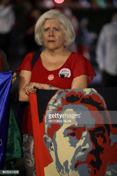 Supporters of Brazilian former president Luiz Inacio Lula da Silva react after knowing the decision of Supreme Court of Justice judge Rosa Weber...