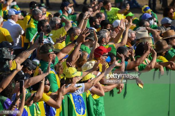 Supporters of Brazilian President Jair Bolsonaro attend the flag-raising ceremony at Alvorada Palace, during the Independence Day celebrations in...