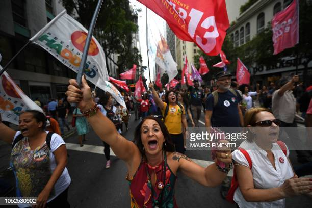 Supporters of Brazilian presidential candidate for the Workers Party Fernando Haddad attend a rally in Buraco do Lume Square downtown Rio de Janeiro...