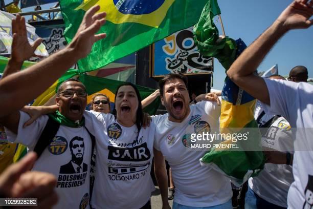 Supporters of Brazilian rightwing presidential candidate Jair Bolsonaro rally at Copacabana beach in Rio de Janeiro Brazil on September 09 2018...