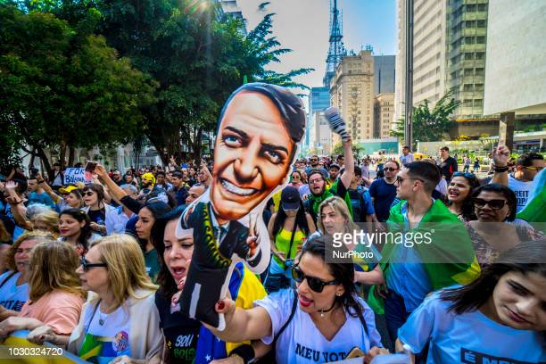 Supporters of Brazilian rightwing presidential candidate Jair Bolsonaro take part in a rally at Paulista Avenue in Sao Paulo Brazil on September 09...