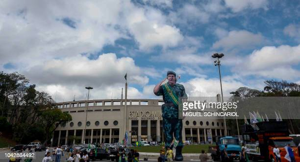 Supporters of Brazilian rightwing presidential candidate Jair Bolsonaro take part in a rally in the front of the Pacaembu stadium in Sao Paulo Brazil...