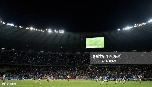 TOPSHOT Supporters of Brazil's Cruzeiro display their mobile phones with the light turned on during the Copa Libertadores football match against...