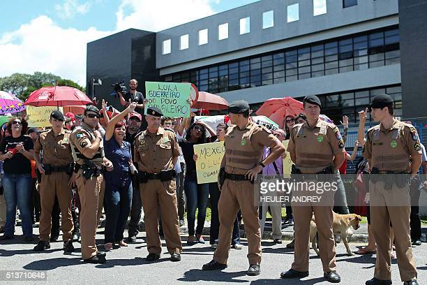 Supporters of Brazil's former president Luiz Inacio Lula da Silva gather in front of the Federal Police headquarters in Curitiba Brazil on March 04...