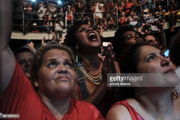Supporters of Brazil's Former president Luiz Inacio Lula da Silva listen to his address at a campaign rally organized by leftwing political parties...