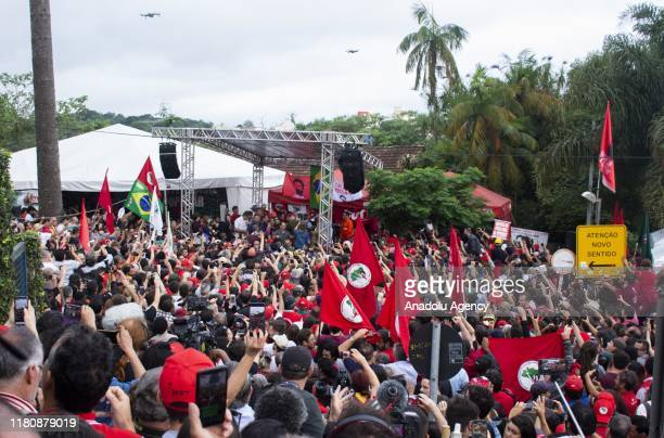 Supporters of Brazil's former President Lula da Silva gather in front of the Federal Police headquarters for his release in Curitiba Brazil on...