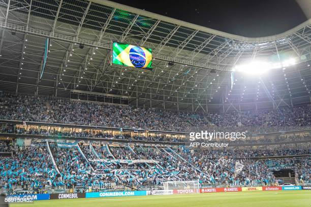 Supporters of Brazil's Gremio cheer before the start of the Copa Libertadores 2017 football match at the Arena do Gremio stadium in Porto Alegre...