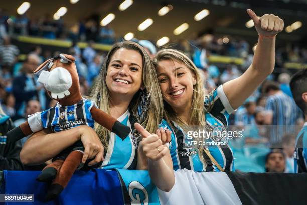 Supporters of Brazil's Gremio wait for the start of the Copa Libertadores 2017 football match against Ecuador's Barcelona at the Arena do Gremio...