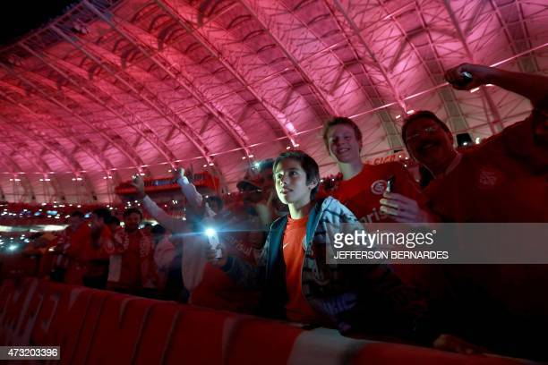 Supporters of Brazil's Internacional cheer for their team before the start of their Copa Libertadores football match against Brazil's Atletico...