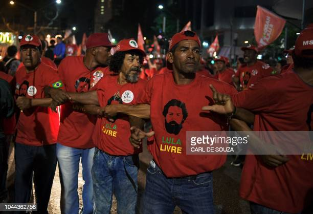 TOPSHOT Supporters of Brazil's presidential candidate Fernando Haddad form a security cordon during a campaign rally in Rio de Janeiro Brazil on...