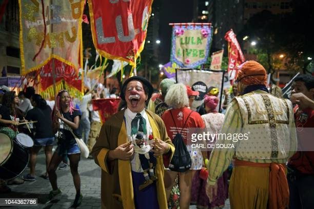 Supporters of Brazil's presidential candidate Fernando Haddad take part in a campaign rally in Rio de Janeiro Brazil on October 1 2018 Leftist...