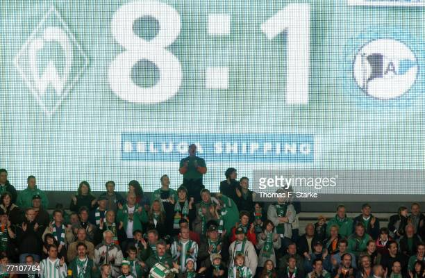 Supporters of Bremen celebrate during the Bundesliga match between Werder Bremen and Arminia Bielefeld at the Weser stadium on September 29 2007 in...