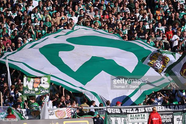 Supporters of Bremen cheer their team during the Bundesliga match between Werder Bremen and Energie Cottbus at the Weser stadium on September 13 2008...