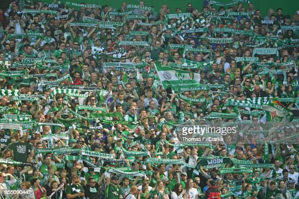 Supporters of Bremen cheer their team during the Bundesliga match between SV Werder Bremen and Bayer 04 Leverkusen at Weserstadion on May 5 2018 in...