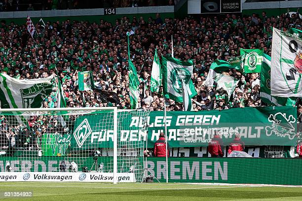 Supporters of Bremen display posters before the Bundesliga match SV Werder Bremen and Eintracht Frankfurt at Weserstadion on May 14 2016 in Bremen...