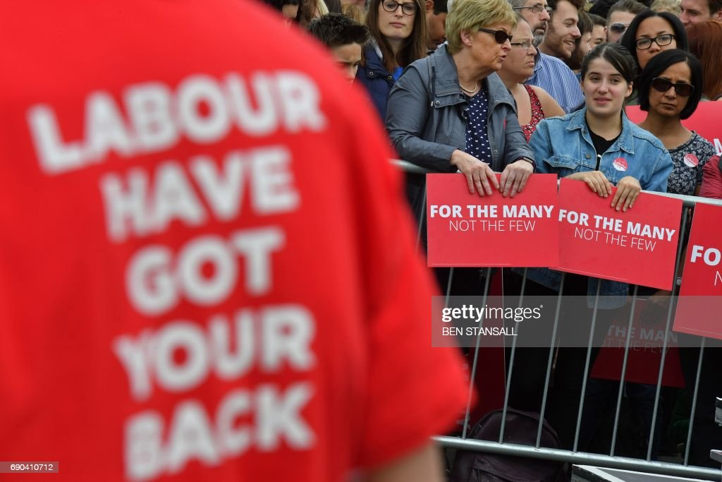 TOPSHOT - Supporters of Britain's main opposition Labour party await the arrival of th party's leader, Jeremy Corbyn, at a general election campaign event in Reading, west of London, on May 31, 2017, as campaigning continues in the build up to the general election on June 8. PHOTO / Ben STANSALL