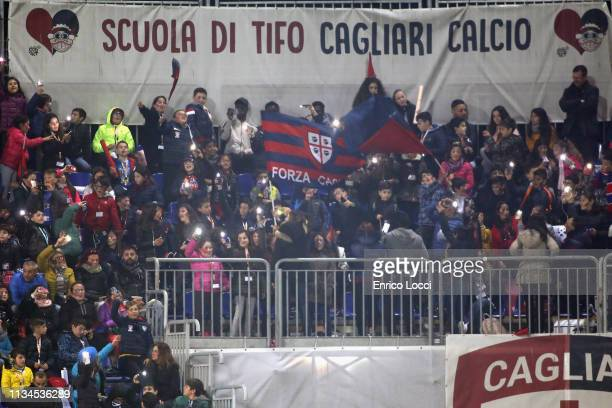 Supporters of Cagliari cheer for their team during the Serie A match between Cagliari and Juventus at Sardegna Arena on April 2 2019 in Cagliari Italy