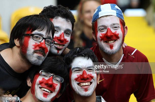 Supporters of Canada cheer before the FIFA Women's World Cup 2011 Group A match between Canada and Nigeria at RudolfHarbigStadion on July 5 2011 in...
