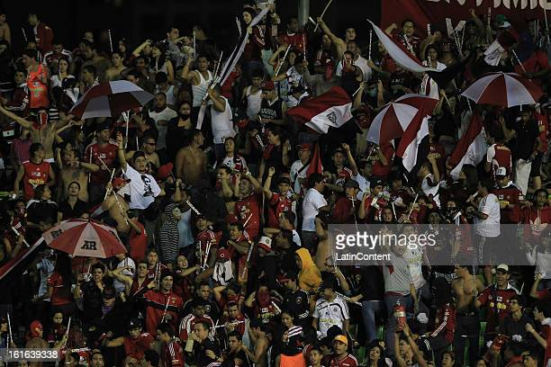 Supporters of Caracas FC cheer their team during a game between Fluminense FC and Caracas as part of the Copa Bridgestone Libertadores 2013 at the...
