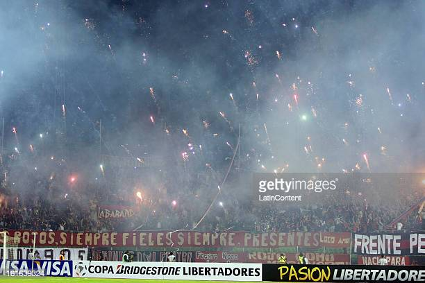 Supporters of Caracas FC launch fireworks before a game between Fluminense FC and Caracas as part of the Copa Bridgestone Libertadores 2013 at the...