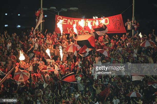 Supporters of Caracas FC support their team during a game between Fluminense FC and Caracas as part of the Copa Bridgestone Libertadores 2013 at the...