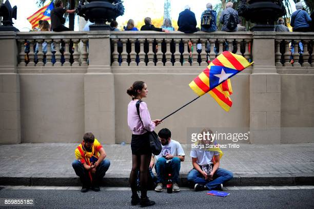 Supporters of Catalan independence await during the declaration of Carles Puigdemont at the Catalan Parliament on October 10 2017 in Barcelona Spain...
