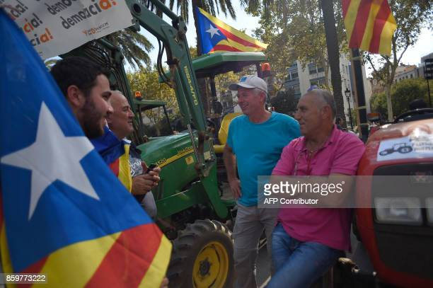 Supporters of Catalan independence drive with tractors through the Arc de Triomf in Barcelona on October 10 2017 Spain's worst political crisis in a...