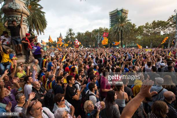 Supporters of Catalan independence gather before the Catalan Parliament for a speech by the region's president Charles Puigdemont on October 10 2017...
