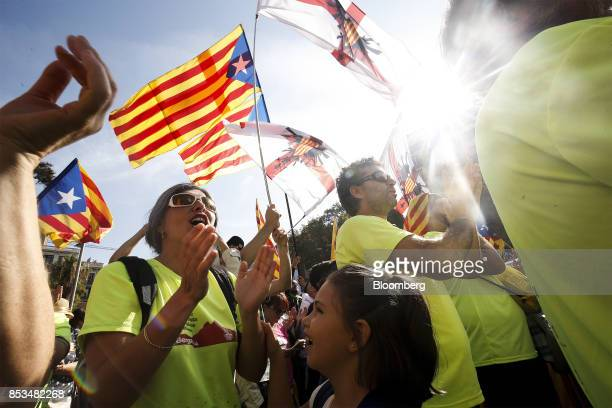 Supporters of Catalan independence wave flags and shout slogans during a demonstration called for by the Catalan National Assembly and Omnium...