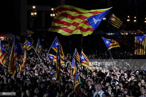 Supporters of Catalan independence wave flags while attending a rally ahead of the vote in Barcelona Spain on Friday Sept 25 2015 With Catalonia...