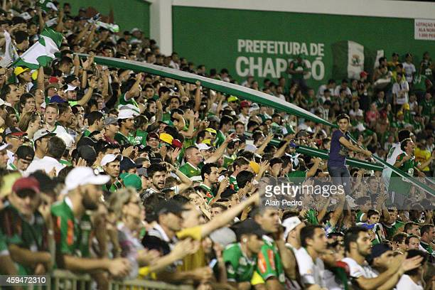 Supporters of Chapecoense cheer their team during the match between Chapecoense and Botafogo for the Brazilian Series A 2014 at Arena Conda Stadium...