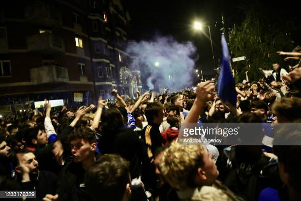 Supporters of Chelsea gather in front of Stamford Bridge Stadium to celebrate the Champions League title, on May 29, 2021 in London, United Kingdom....