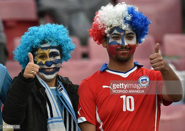 Supporters of Chile and Uruguay cheer for their teams before the start of the 2015 Copa America football championship quarterfinal match Chile vs...