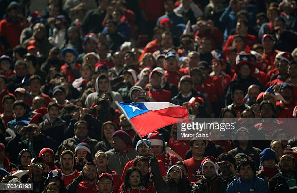 Supporters of Chile cheer for their team prior to a match between Chile and Bolivia as part of the 14th round of the South American Qualifiers for...