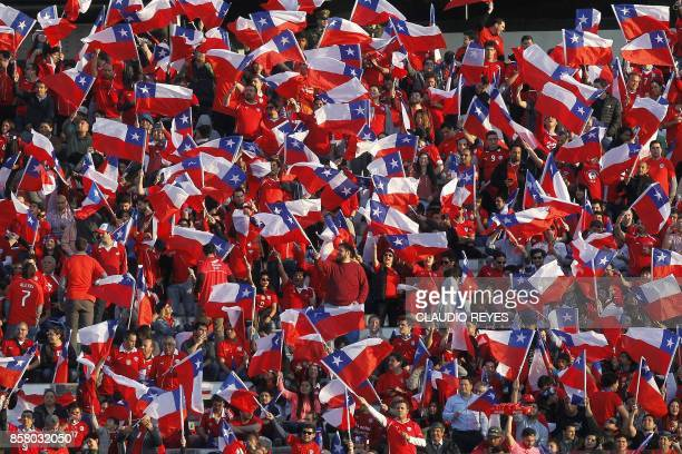 Supporters of Chile wait for the start of the 2018 World Cup football qualifier match against Ecuador in Santiago on October 5 2017 / AFP PHOTO /...