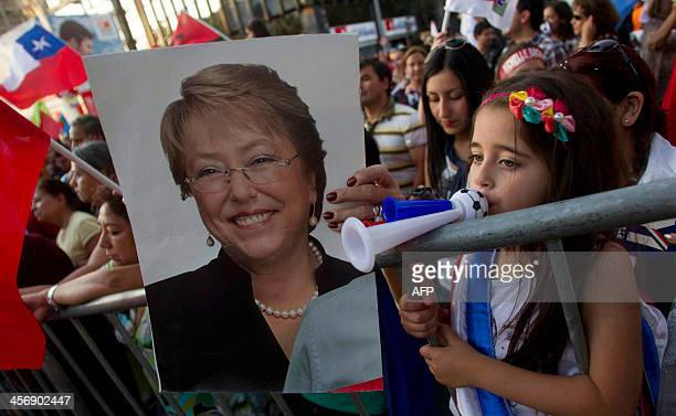 Supporters of Chilean socialist candidate for the New Majority coalition Michelle Bachelet celebrate in front of the party's headquarters in Santiago...
