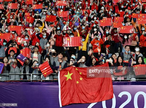 Supporters of China celebrate victory after the Tokyo Olympics Women's Football Asian Final Qualifier 2nd leg match between China and South Korea at...