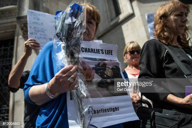 Supporters of Chris Gard and Connie Yates the parents of terminally ill toddler Charlie Gard take part in a demonstration outside the High Court as...