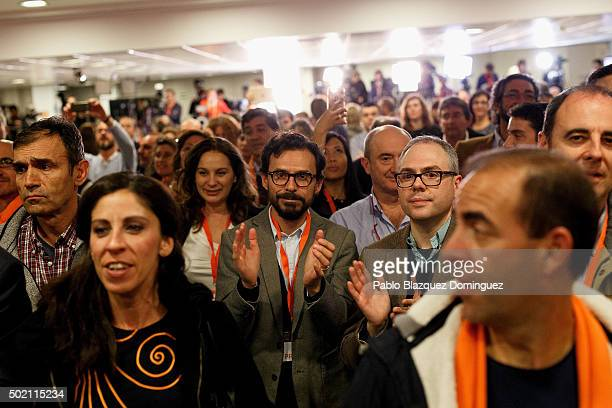 Supporters of Ciudadanos party applaud as their leader Albert Rivera speaks about the final general elections results at Hotel Eurobuilding on...