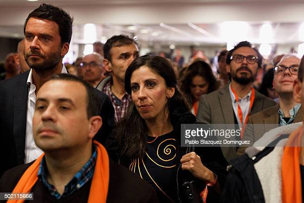 Supporters of Ciudadanos party watch at their leader Albert Rivera speaking about the final general elections results at Hotel Eurobuilding on...