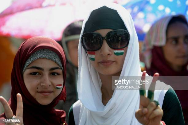Supporters of cleric TahirulQadri show victory sign at an anti government rally in Islamabad on August 16 2014 Pakistan's Imran Khan vowed thousands...