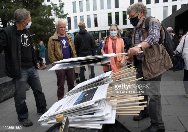 Supporters of climate activists pile placards on September 24 2020 in Renens near Lausanne after the verdict of an appeal by the canton Vaud attorney...