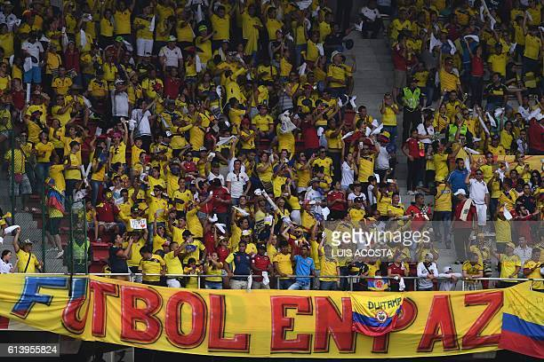 TOPSHOT Supporters of Colombia wait for the start of the Russia 2018 FIFA World Cup qualifier football match against Uruguay in Barranquilla Colombia...