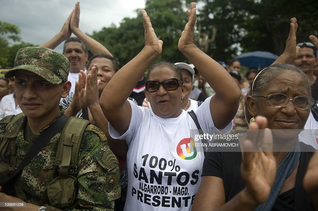 Supporters of Colombian former Defense Minister and presidential candidate for the ruling National Unity party Juan Manuel Santos (not depicted) cheer during a rally in Aracataca, department of Magdalena, Colombia's Caribbean Region on May 20, 2010. Colombia will hold the presidential elections next May 30, and according to polls, a run-off election between Colombian presidential candidate for the Green Party, Antanas Mockus and Santos will take place on June 20. AFP PHOTO/Eitan Abramovich