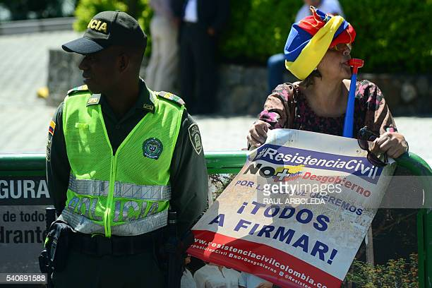 Supporters of Colombian former President and current Senator Alvaro Uribe protest against the government of Colombian President Juan Manuel Santos...