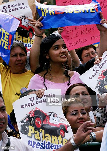 Supporters of Colombian President Alvaro Uribe Velez shout slogans and display posters during a campaign rally in Armenia Colombia Wednesday May 17...