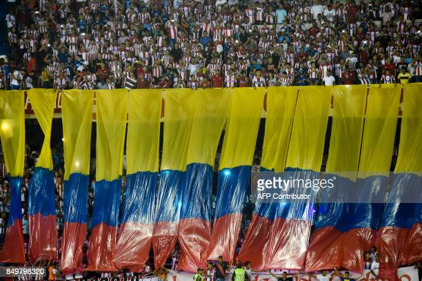 Supporters of Colombia's Atletico Junior cheer for their team before the start of their Copa Sudamericana football match againts Paraguay's Cerro...