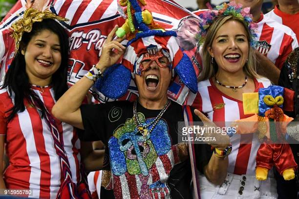 Supporters of Colombia's Junior cheer for their team before a Copa Libertadores football match against Paraguay's Olimpia at Roberto Melendez stadium...