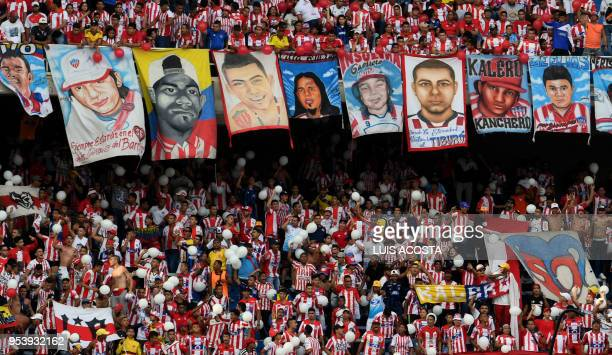 TOPSHOT Supporters of Colombia's Junior cheer for their team during the 2018 Copa Libertadores football match against Argentina's Boca Juniors at the...
